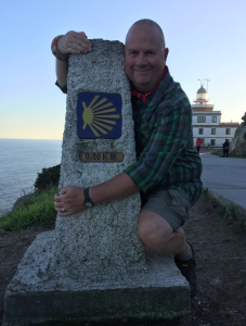 At the Zero marker in Fisterra, Galicia, Spain.