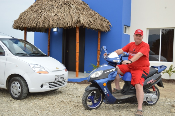At the East entrance to Casa Azul with my new moto and our rented Chevy Spark.