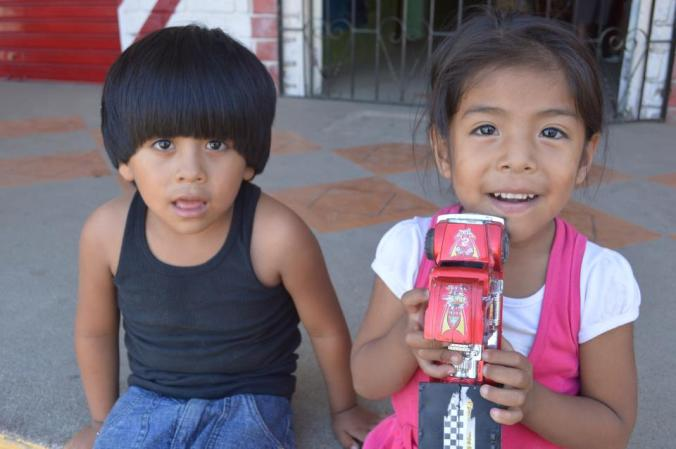 Brother and sister, near their father's street market in Puerto Lopez, Ecuador.