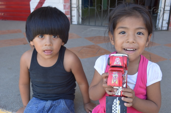 Beautiful children near their father's street market in Puerto Lopez.