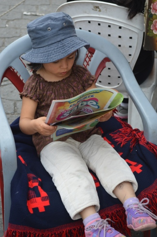 Catching up on her reading.