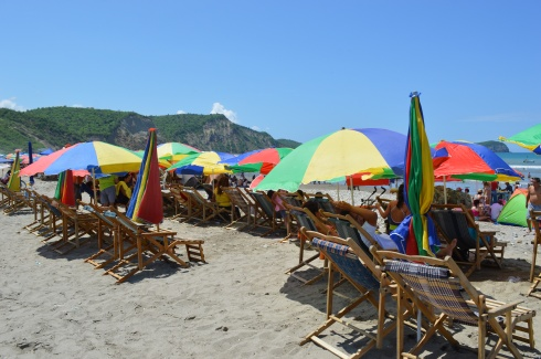 Umbrellas everywhere. Why? Because on a sunny day like today at this latitude, 30 minutes in the sun can  send a fair-skinned gringo to the hospital.