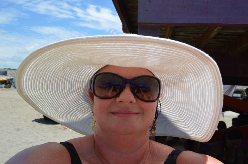 Biggest hat on the beach.