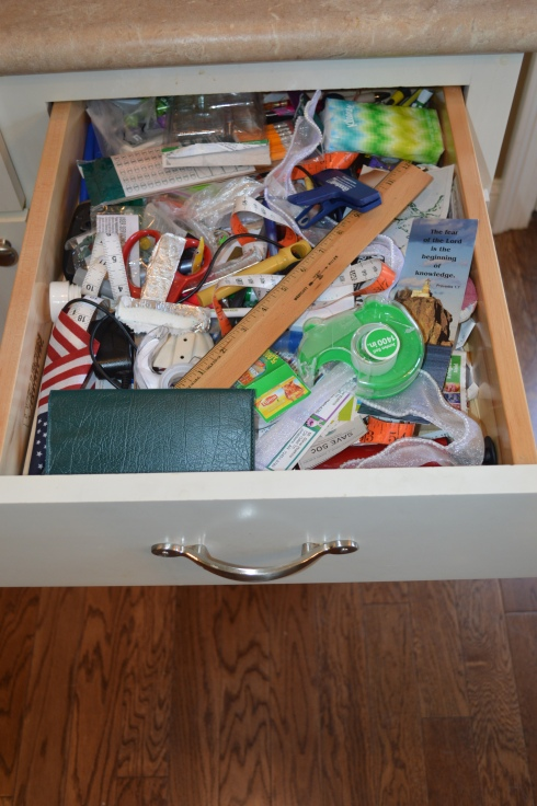 Our primary junk drawer in all its glory.