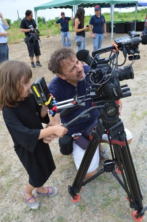 Doron Schlair of New York, takes time to let an Ecuadorian child look through his camera lens on our first day of filming. Doron is a real artist behind the camera.