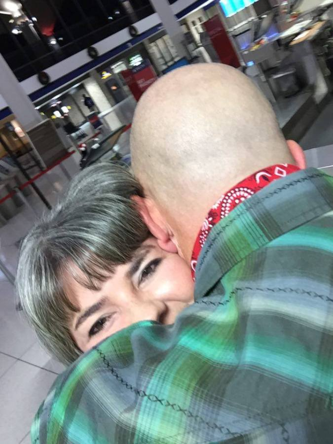 Thursday Night at Memphis International Airport after 11 hours on a plane. My #1 fan and the woman I love.