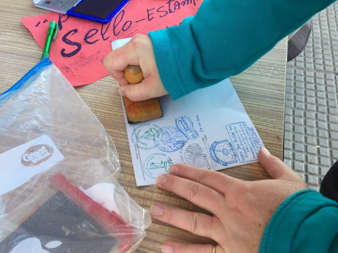 Stamping the pilgrim's credencial, proof of the journey for your compostela upon arrival in Santiago.